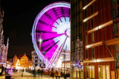 The Amber Sky, a panoramic ferris wheel, is just across the River Motława from the Green Gate.